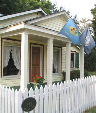 Front of cottage behind picket fence